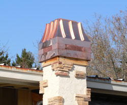 After <br> Even this small front facing chimney benefits from the addition of our Copper Chimney Cap. <br />Hearthside Fireplace, Lake Geneva, WI