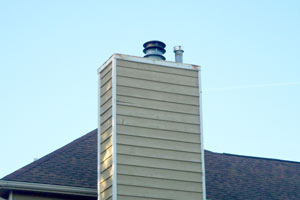 Before <br> The chimney chase is an often overlooked part of a home's appearance. The flat chase top with metal pipes protruding from it is a very unappealing and industrial look.