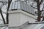 Slate Grey Regal on a white stucco chimney chase.