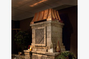 #6 Emperor in Copper atop an outdoor fireplace from Harmony Outdoor Living
